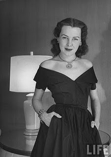 Frances Bergen in off-the-shoulder dress, wearing charm around her neck and several charm bracelets_